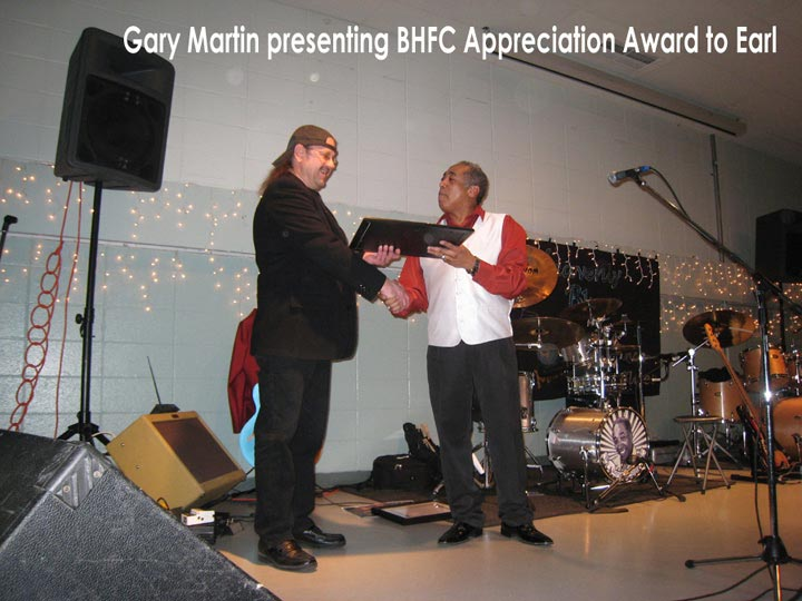 Gary Martin presenting Certificate of Appreciation to Earl
